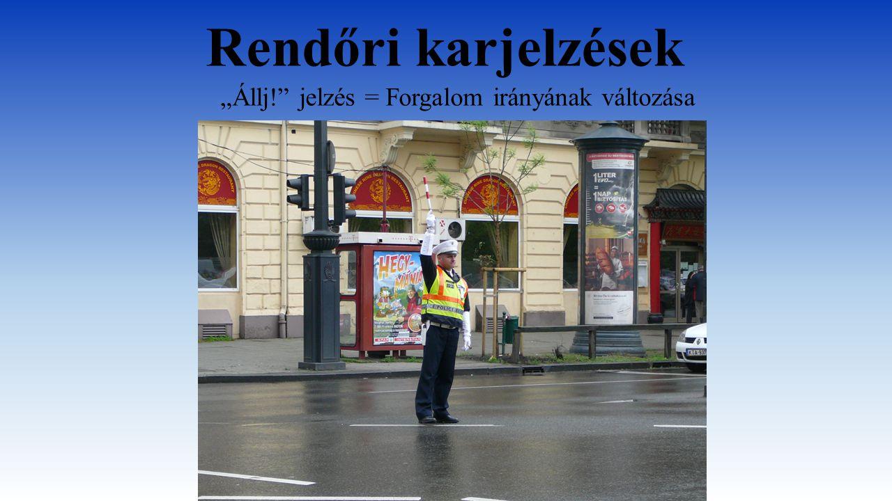 """Rendőri karjelzések """"Állj!"""" jelzés = Forgalom irányának változása"""