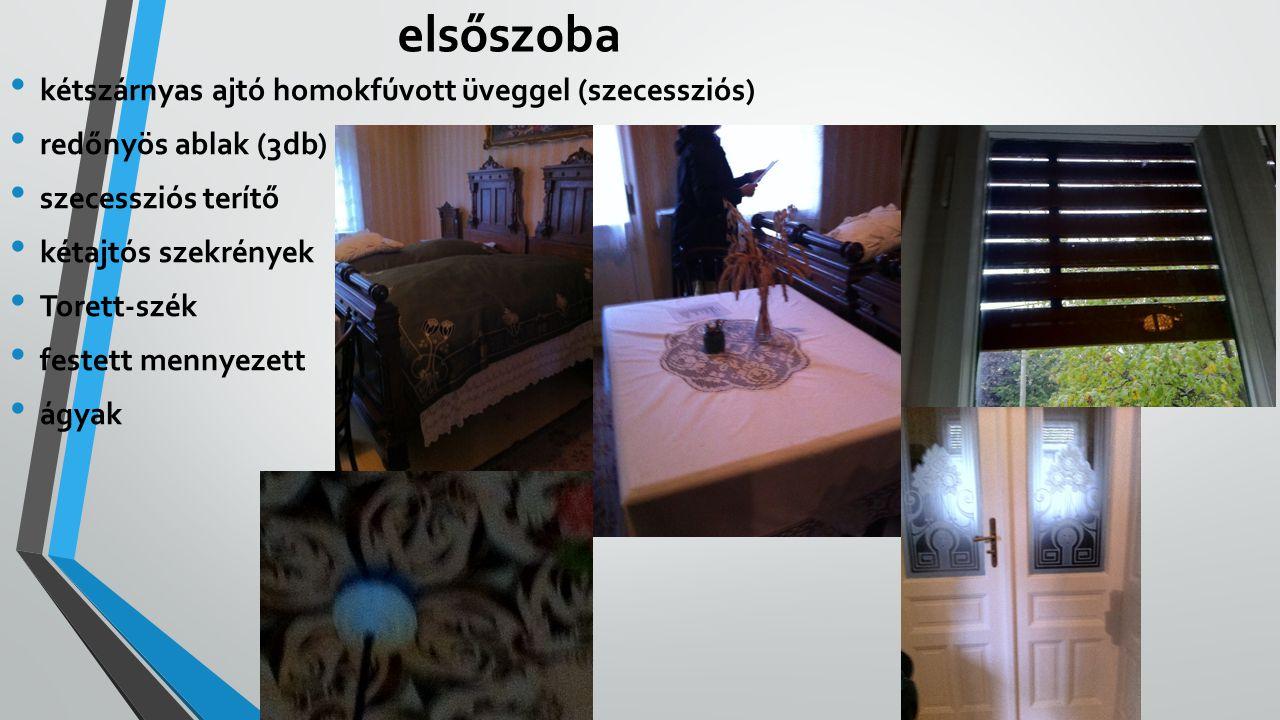 hátsószoba faragott asztal étkezés (csak ünnepkor) varrógép (Siemens) koszorú kép éjjeliedény Jézus és Mária szobra szecessziós lámpa ágy