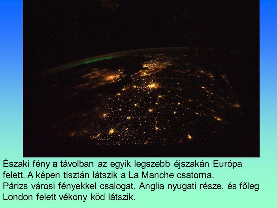 Északi fény a távolban az egyik legszebb éjszakán Európa felett.