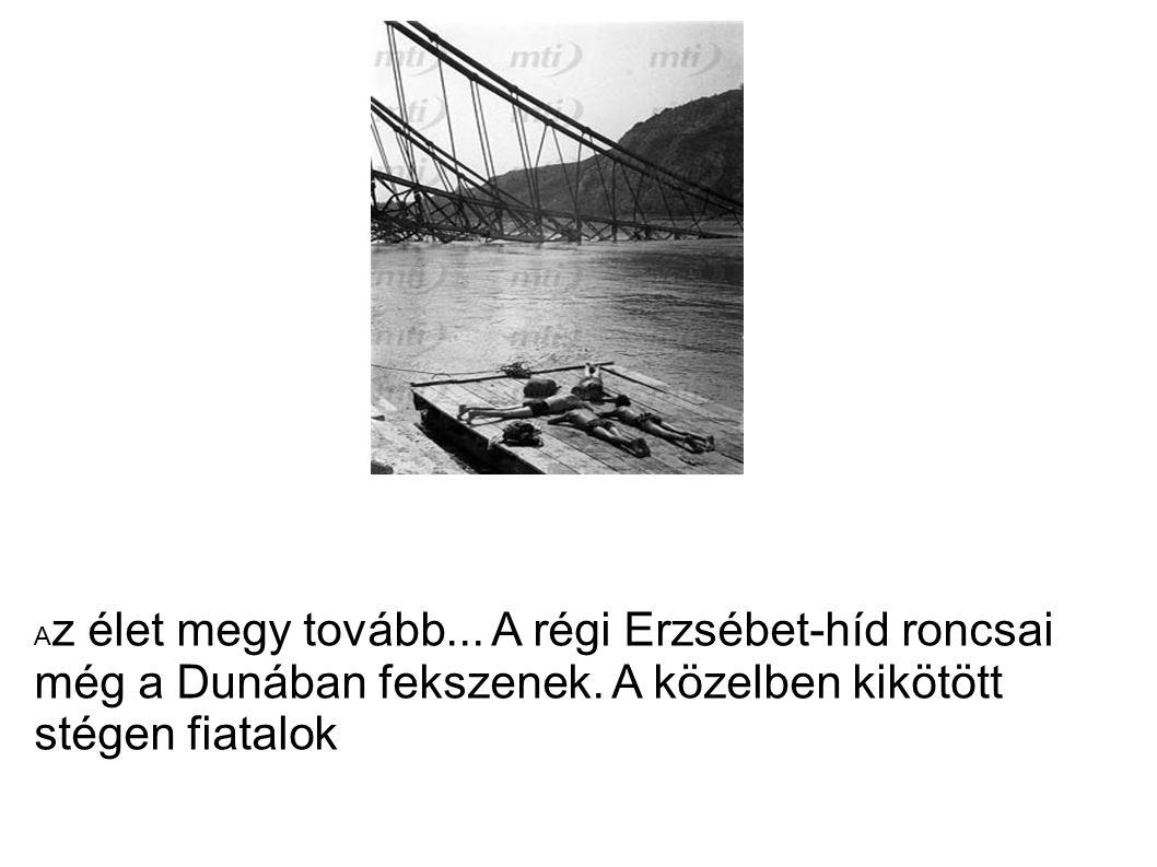 A z élet megy tovább... A régi Erzsébet-híd roncsai még a Dunában fekszenek. A közelben kikötött stégen fiatalok