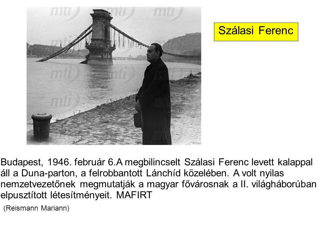 Budapest, 1946. február 6.A megbilincselt Szálasi Ferenc levett kalappal áll a Duna-parton, a felrobbantott Lánchíd közelében. A volt nyilas nemzetvez