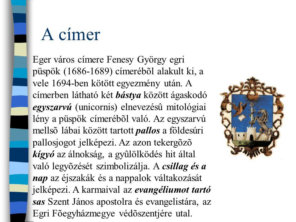A címer Eger város címere Fenesy György egri püspök (1686-1689) címerébõl alakult ki, a vele 1694-ben kötött egyezmény után. A címerben látható két bá