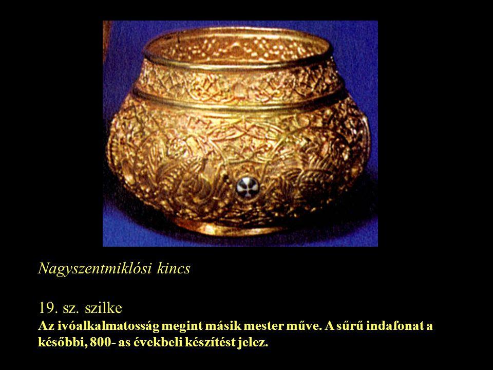 Nagyszentmiklósi kincs 19. sz. szilke Az ivóalkalmatosság megint másik mester műve. A sűrű indafonat a későbbi, 800- as évekbeli készítést jelez.
