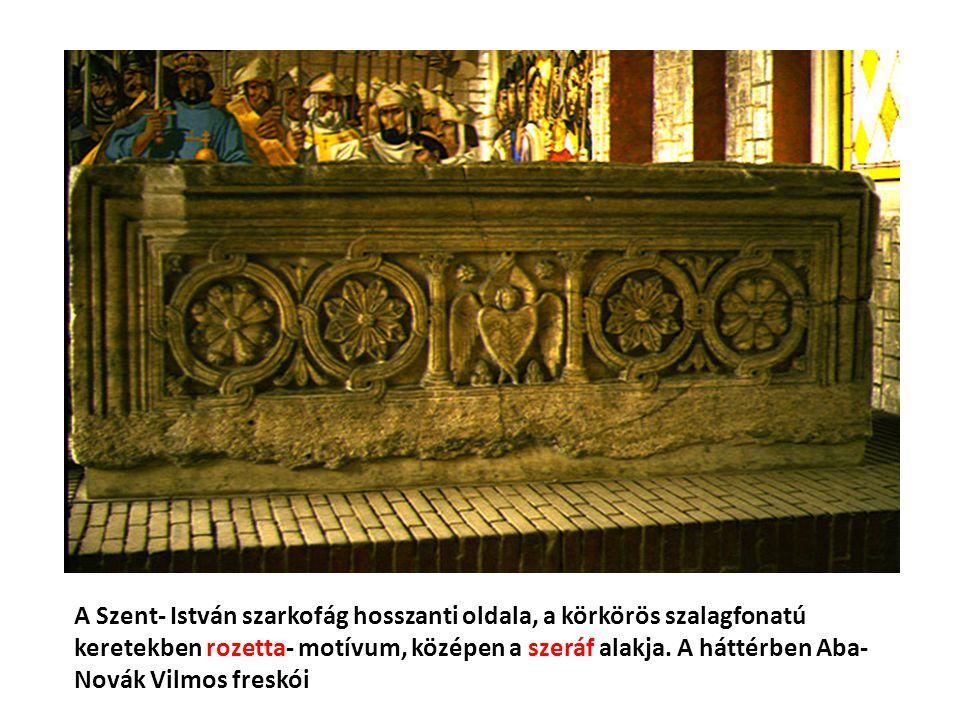 A Szent- István szarkofág hosszanti oldala, a körkörös szalagfonatú keretekben rozetta- motívum, középen a szeráf alakja. A háttérben Aba- Novák Vilmo