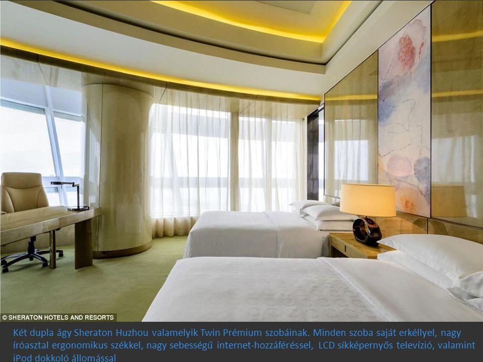 Két dupla ágy Sheraton Huzhou valamelyik Twin Prémium szobáinak. Minden szoba saját erkéllyel, nagy íróasztal ergonomikus székkel, nagy sebességű inte