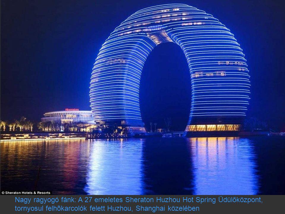 Nagy ragyogó fánk: A 27 emeletes Sheraton Huzhou Hot Spring Üdülőközpont, tornyosul felhõkarcolók felett Huzhou, Shanghai közelében