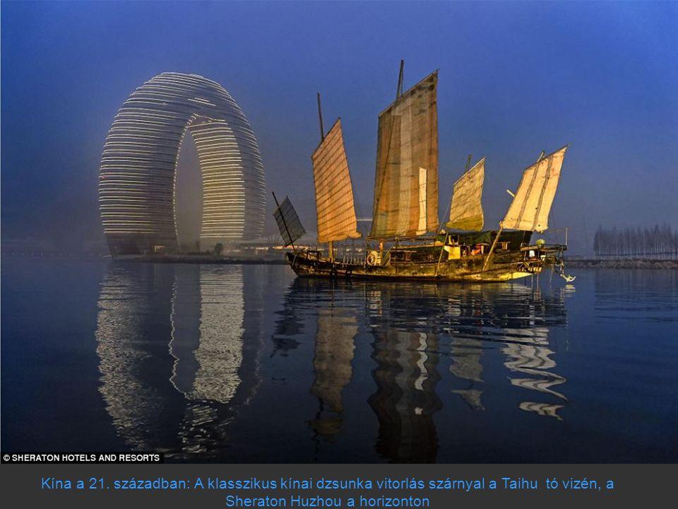 Kína a 21. században: A klasszikus kínai dzsunka vitorlás szárnyal a Taihu tó vizén, a Sheraton Huzhou a horizonton