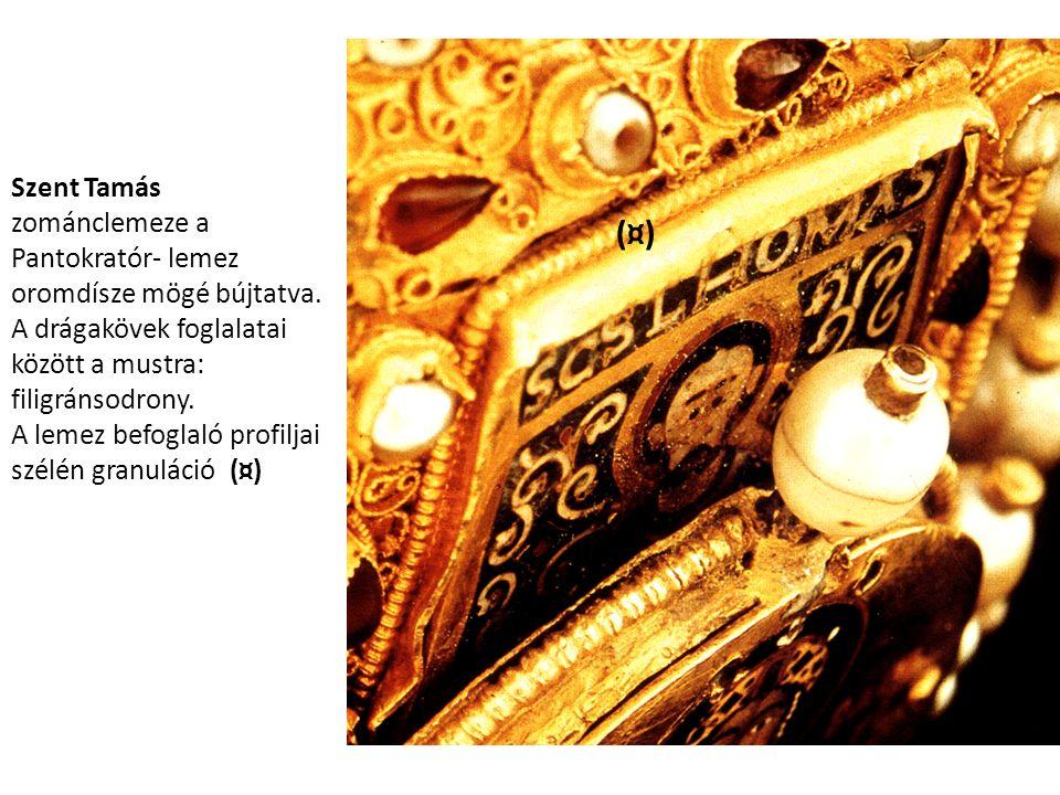 Szent Tamás zománclemeze a Pantokratór- lemez oromdísze mögé bújtatva. A drágakövek foglalatai között a mustra: filigránsodrony. A lemez befoglaló pro