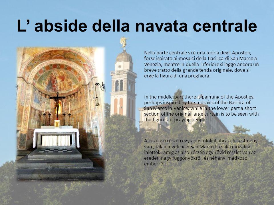 L' abside della navata centrale Nella parte centrale vi è una teoria degli Apostoli, forse ispirato ai mosaici della Basilica di San Marco a Venezia, mentre in quella inferiore si legge ancora un breve tratto della grande tenda originale, dove si erge la figura di una preghiera.
