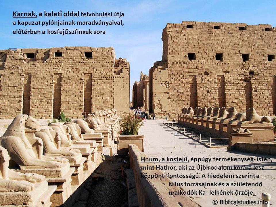 Karnak, a keleti oldal felvonulási útja a kapuzat pylónjainak maradványaival, előtérben a kosfejű szfinxek sora Hnum, a kosfejű, éppúgy termékenység- isten, mint Hathor, aki az Újbirodalom korára lesz központi fontosságú.