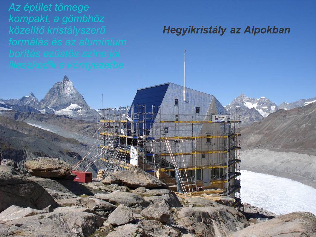 Hegyikristály az Alpokban Az épület tömege kompakt, a gömbhöz közelítő kristályszerű formálás és az alumínium borítás ezüstös színe jól illeszkedik a környezetbe