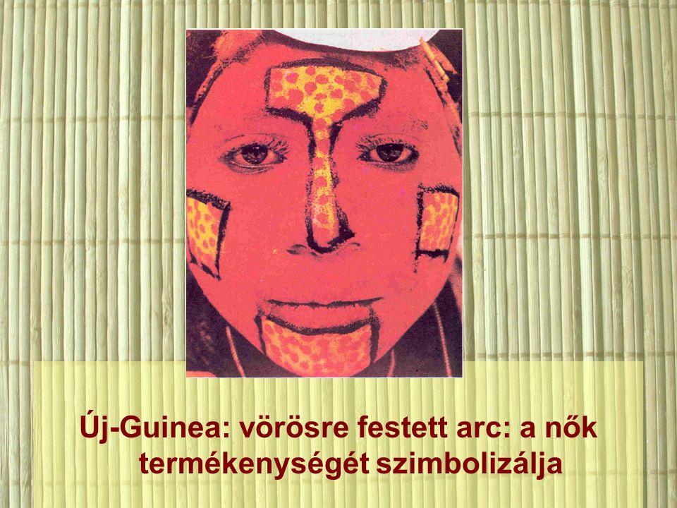Új-Guinea: vörösre festett arc: a nők termékenységét szimbolizálja