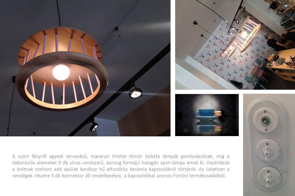 A szórt fényről egyedi tervezésű, macaron ihlette tömör bükkfa lámpák gondoskodnak, míg a dekorációs elemeket 9 db sínes rendszerű, korong formájú hal