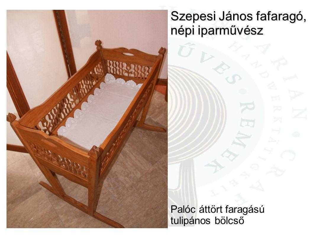 Szepesi János fafaragó, népi iparművész Palóc áttört faragású tulipános bölcső