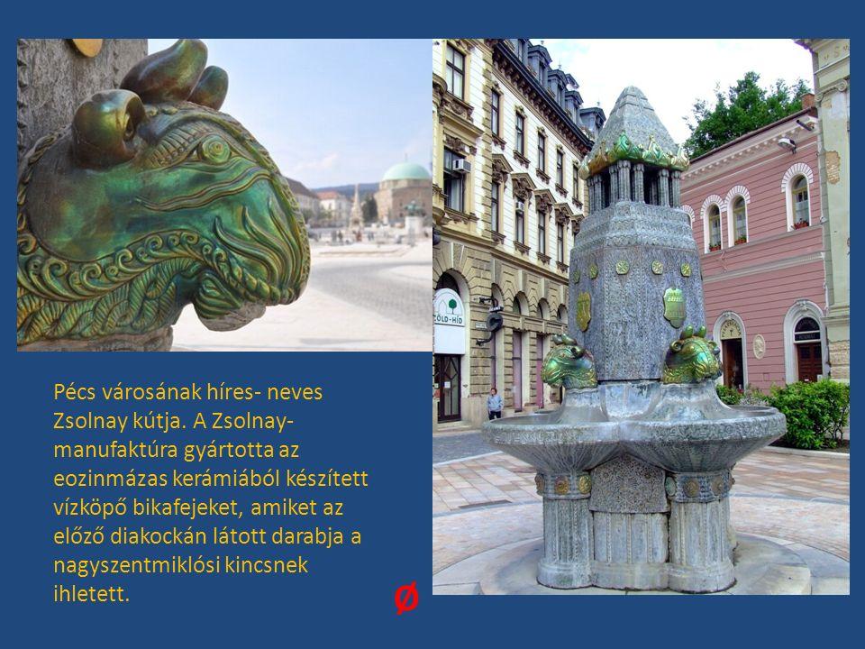 Pécs városának híres- neves Zsolnay kútja. A Zsolnay- manufaktúra gyártotta az eozinmázas kerámiából készített vízköpő bikafejeket, amiket az előző di
