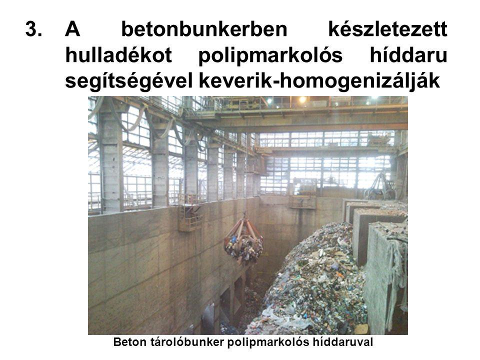 3.A betonbunkerben készletezett hulladékot polipmarkolós híddaru segítségével keverik-homogenizálják Beton tárolóbunker polipmarkolós híddaruval