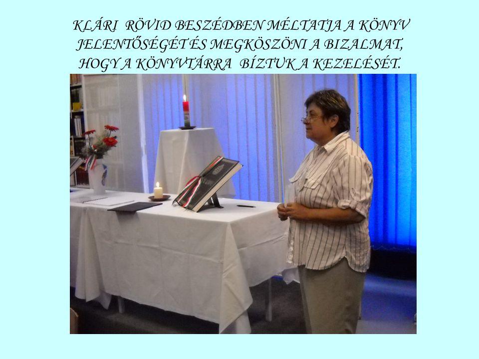 KLÁRI RÖVID BESZÉDBEN MÉLTATJA A KÖNYV JELENTŐSÉGÉT ÉS MEGKÖSZÖNI A BIZALMAT, HOGY A KÖNYVTÁRRA BÍZTUK A KEZELÉSÉT.