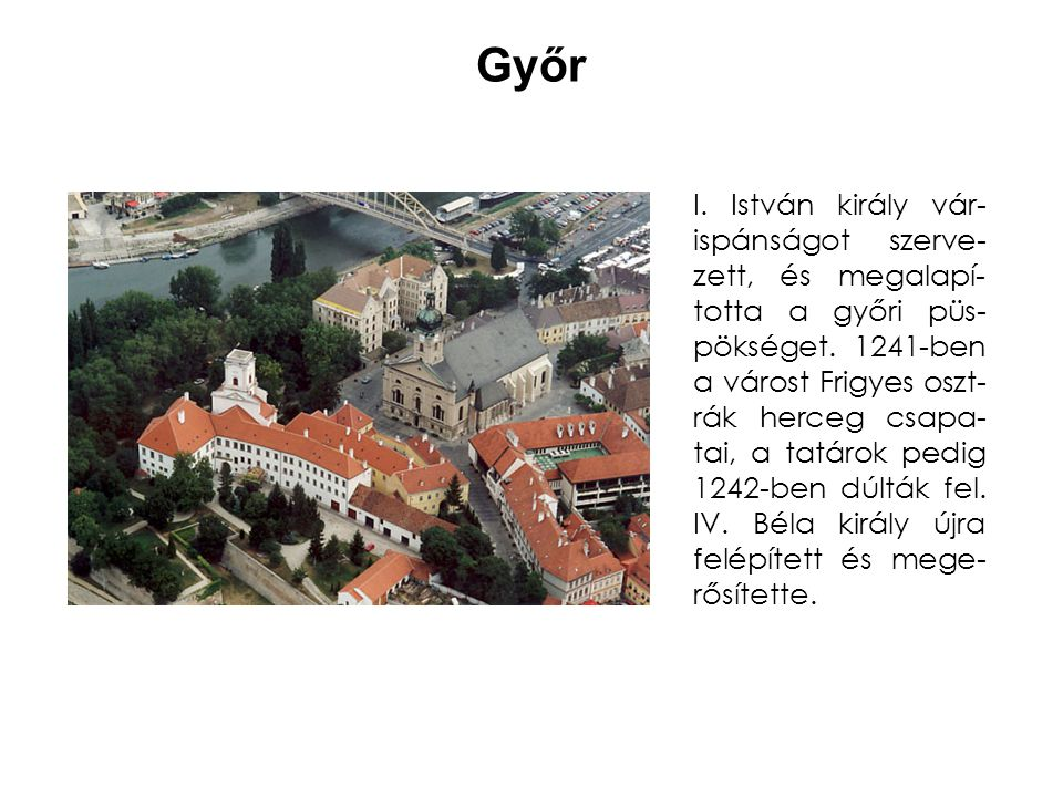 A várkastélyt és a várost négyszög alak- ban várfal vette körül., melyet négy kör alap- rajzú torony erősített.