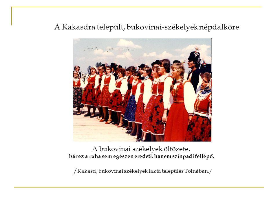 A bukovinai székelyek öltözete, bár ez a ruha sem egészen eredeti, hanem színpadi fellépő. / Kakasd, bukovinai székelyek lakta település Tolnában./ A