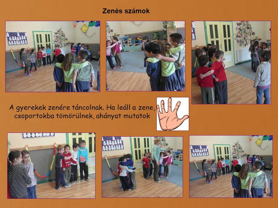 Zenés számok A gyerekek zenére táncolnak. Ha leáll a zene, csoportokba tömörülnek, ahányat mutatok
