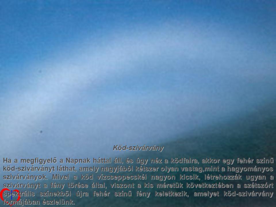 Köd-szivárvány Ha a megfigyelő a Napnak háttal áll, és úgy néz a ködfalra, akkor egy fehér színű köd-szivárványt láthat, amely nagyjából kétszer olyan vastag,mint a hagyományos szivárványok.