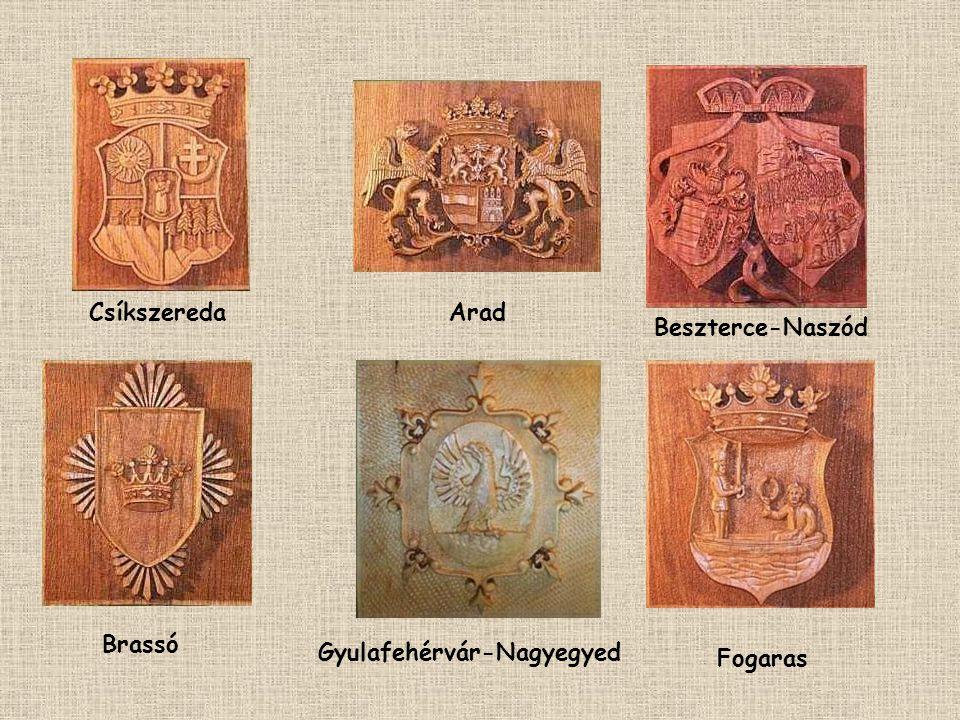 MAGYAR KIRÁLYSÁG FÁBÓL FARAGOTT CÍMEREI ERDÉLYI RÉSZBEN. GODA LÁSZLÓ FERENC FAFARAGÓ Az akkori városok nevei szerepelnek a címerek alatt. MEGYÉK CÍMER