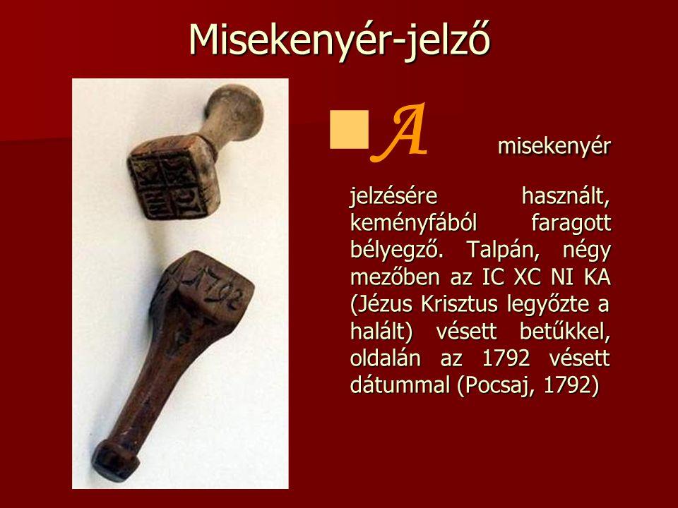 Misekenyér-jelző  misekenyér jelzésére használt, keményfából faragott bélyegző. Talpán, négy mezőben az IC XC NI KA (Jézus Krisztus legyőzte a halált