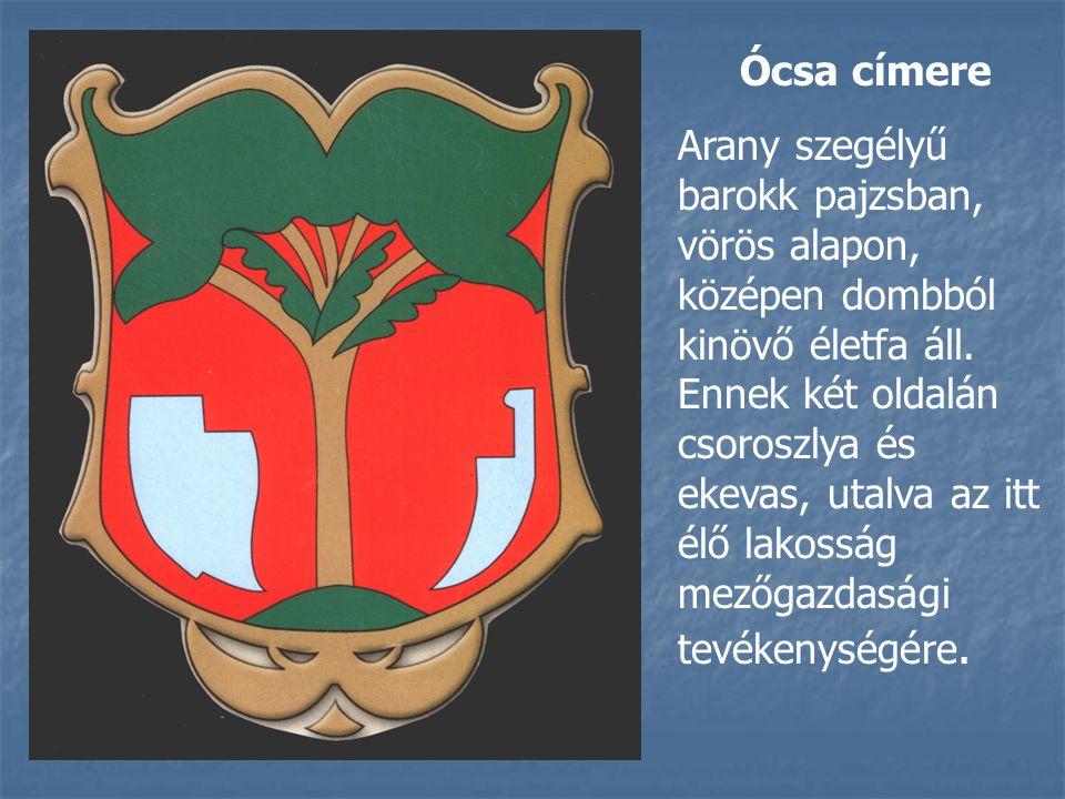 Ócsa címere Arany szegélyű barokk pajzsban, vörös alapon, középen dombból kinövő életfa áll.