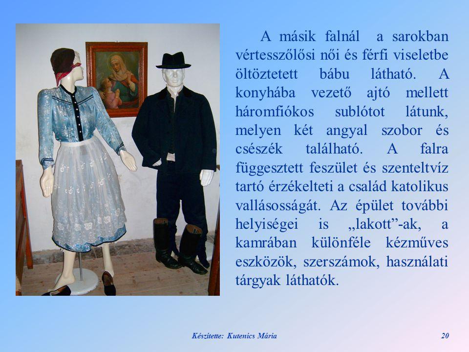 Készítette: Kutenics Mária20 A másik falnál a sarokban vértesszőlősi női és férfi viseletbe öltöztetett bábu látható. A konyhába vezető ajtó mellett h