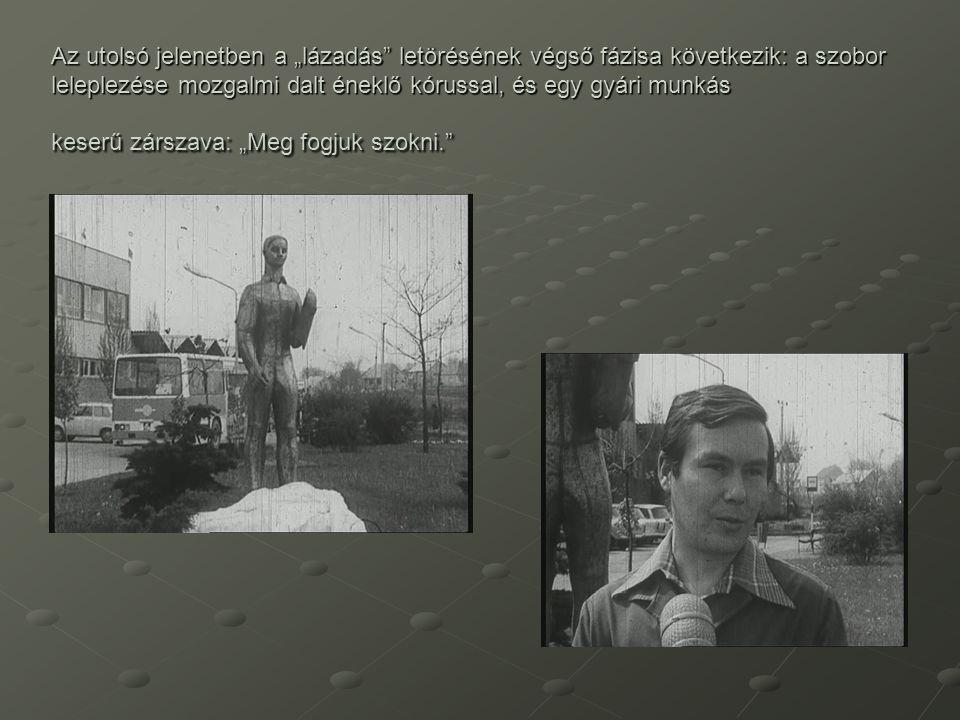 """Az utolsó jelenetben a """"lázadás"""" letörésének végső fázisa következik: a szobor leleplezése mozgalmi dalt éneklő kórussal, és egy gyári munkás keserű z"""