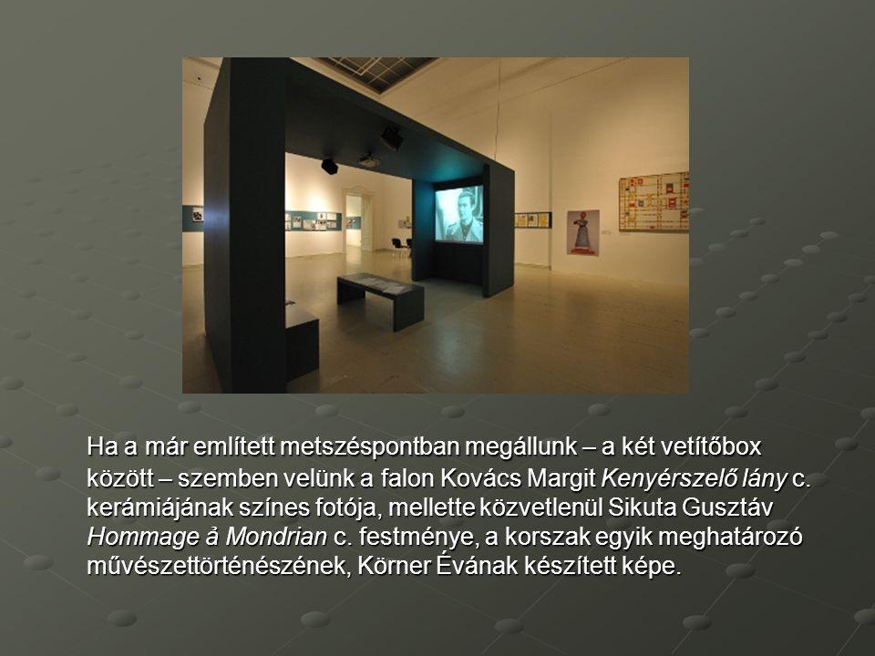 Ha a már említett metszéspontban megállunk – a két vetítőbox között – szemben velünk a falon Kovács Margit Kenyérszelő lány c. kerámiájának színes fot