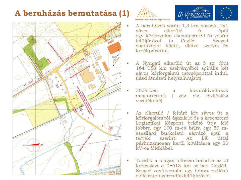 •A beruházás során 1,3 km hosszú, 2x1 sávos elkerülő út épül egy körforgalmi csomóponttal és vasúti felüljáróval (a Cegléd - Szeged vasútvonal felett), illetve szerviz és kerékpárúttal.