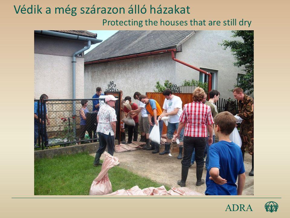 ADRA Védik a még szárazon álló házakat Protecting the houses that are still dry