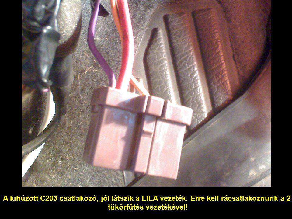 A kihúzott C203 csatlakozó, jól látszik a LILA vezeték. Erre kell rácsatlakoznunk a 2 tükörfűtés vezetékével!