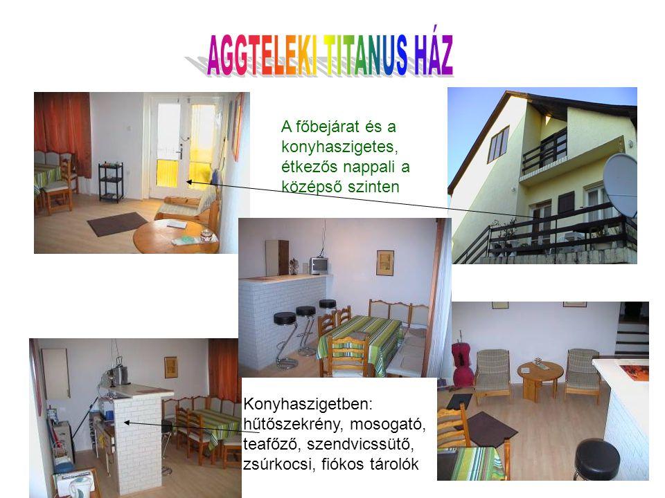 A főbejárat és a konyhaszigetes, étkezős nappali a középső szinten Konyhaszigetben: hűtőszekrény, mosogató, teafőző, szendvicssütő, zsúrkocsi, fiókos tárolók