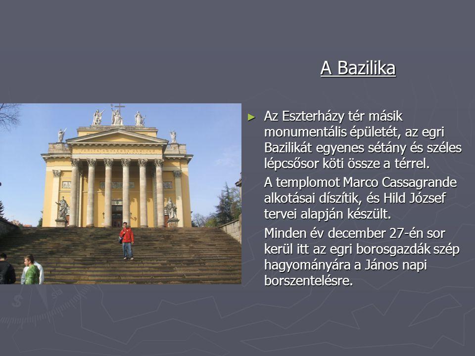 A Bazilika ► Az Eszterházy tér másik monumentális épületét, az egri Bazilikát egyenes sétány és széles lépcsősor köti össze a térrel. A templomot Marc