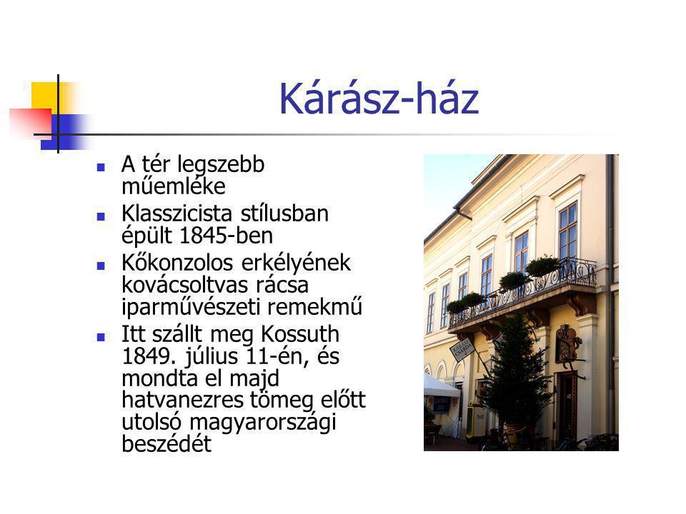 Kárász-ház  A tér legszebb műemléke  Klasszicista stílusban épült 1845-ben  Kőkonzolos erkélyének kovácsoltvas rácsa iparművészeti remekmű  Itt sz
