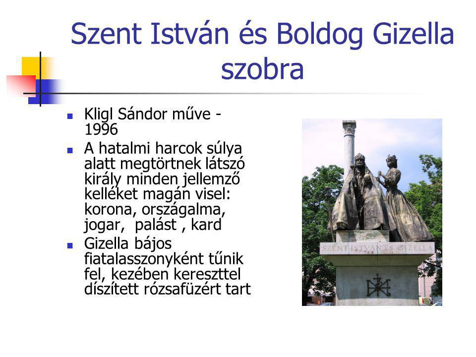 Szent István és Boldog Gizella szobra  Kligl Sándor műve - 1996  A hatalmi harcok súlya alatt megtörtnek látszó király minden jellemző kelléket magá