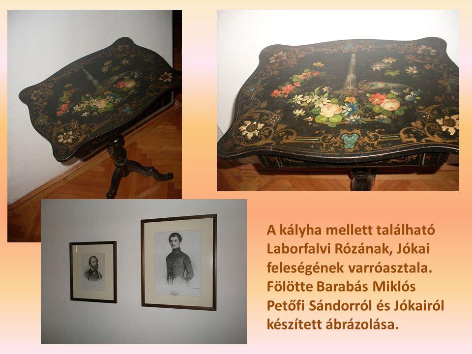 A kályha mellett található Laborfalvi Rózának, Jókai feleségének varróasztala. Fölötte Barabás Miklós Petőfi Sándorról és Jókairól készített ábrázolás