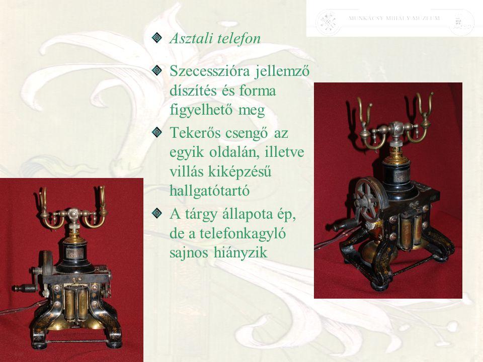 Asztali telefon Szecesszióra jellemző díszítés és forma figyelhető meg Tekerős csengő az egyik oldalán, illetve villás kiképzésű hallgatótartó A tárgy