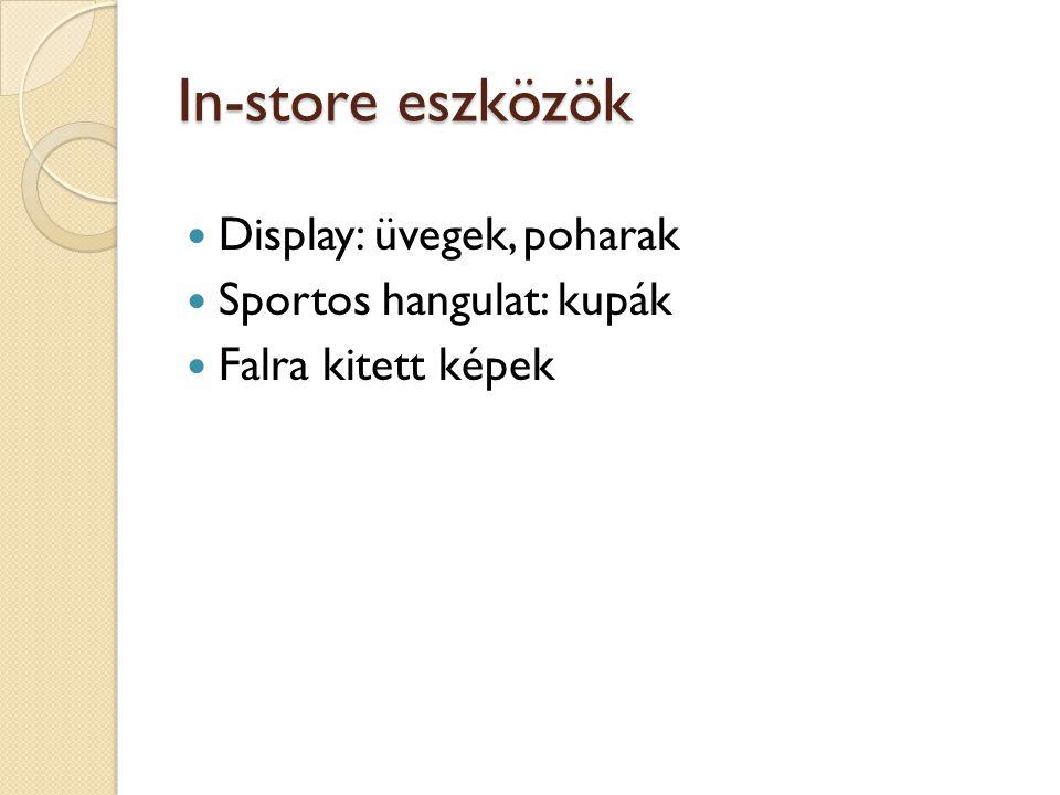 In-store eszközök  Display: üvegek, poharak  Sportos hangulat: kupák  Falra kitett képek