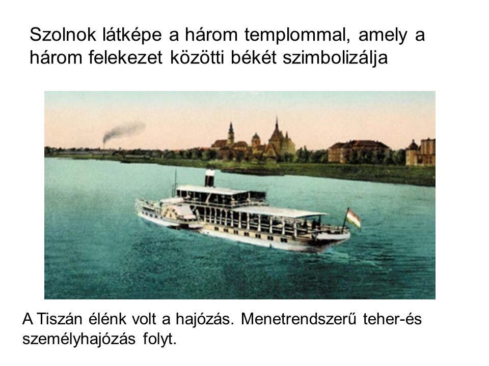Szolnok látképe a három templommal, amely a három felekezet közötti békét szimbolizálja A Tiszán élénk volt a hajózás.