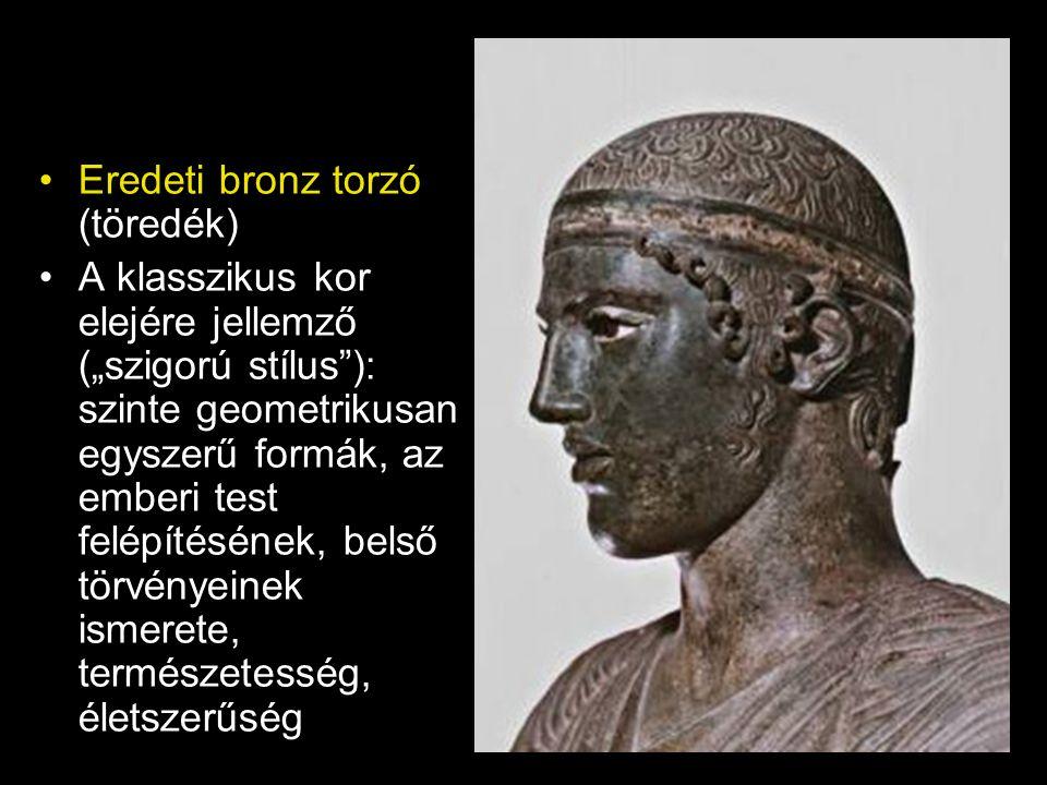 """•Eredeti bronz torzó (töredék) •A klasszikus kor elejére jellemző (""""szigorú stílus""""): szinte geometrikusan egyszerű formák, az emberi test felépítésén"""