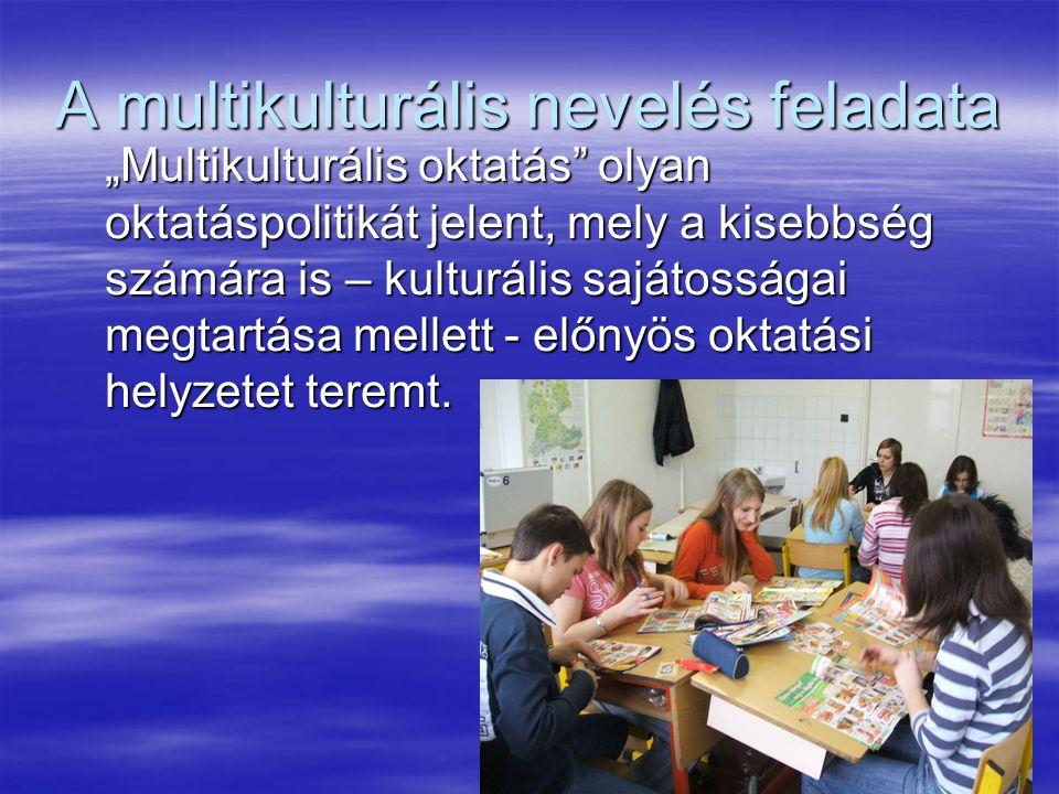 """21 A multikulturális nevelés feladata """"Multikulturális oktatás olyan oktatáspolitikát jelent, mely a kisebbség számára is – kulturális sajátosságai megtartása mellett - előnyös oktatási helyzetet teremt."""