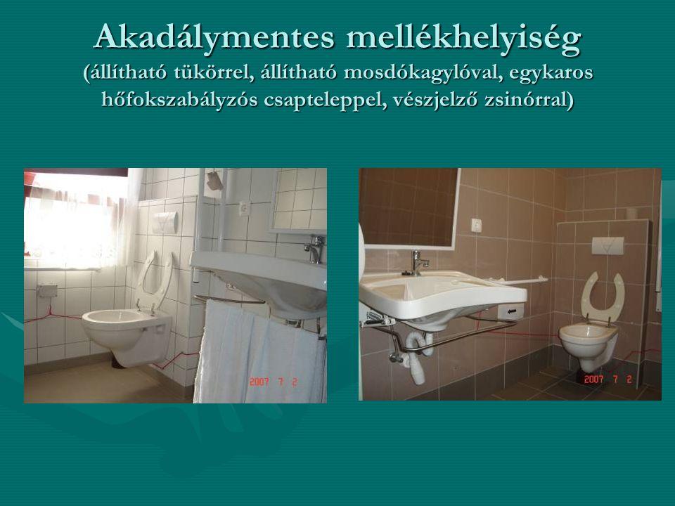 Akadálymentes mellékhelyiség (állítható tükörrel, állítható mosdókagylóval, egykaros hőfokszabályzós csapteleppel, vészjelző zsinórral)