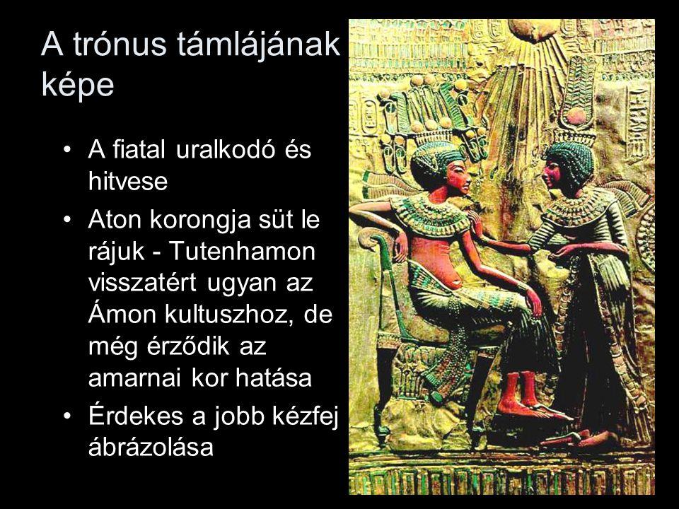 A trónus támlájának képe A fiatal uralkodó és hitvese Aton korongja süt le rájuk - Tutenhamon visszatért ugyan az Ámon kultuszhoz, de még érződik az amarnai kor hatása Érdekes a jobb kézfej ábrázolása