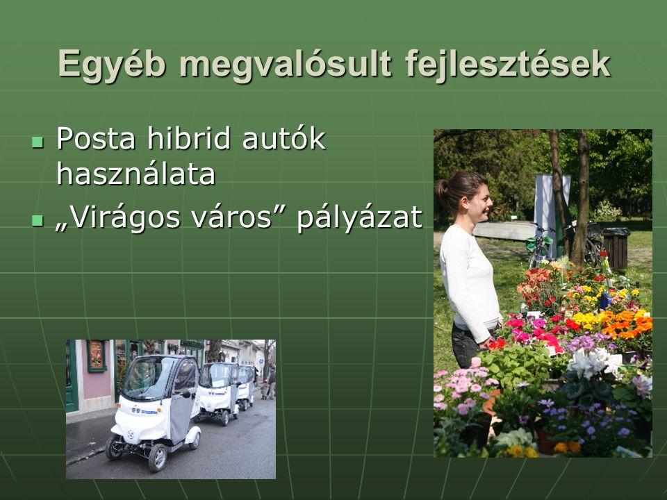 """Egyéb megvalósult fejlesztések Posta hibrid autók használata Posta hibrid autók használata """"Virágos város pályázat """"Virágos város pályázat"""