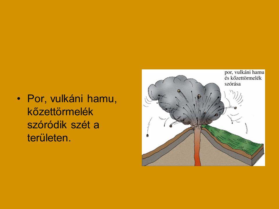 Por, vulkáni hamu, kőzettörmelék szóródik szét a területen.