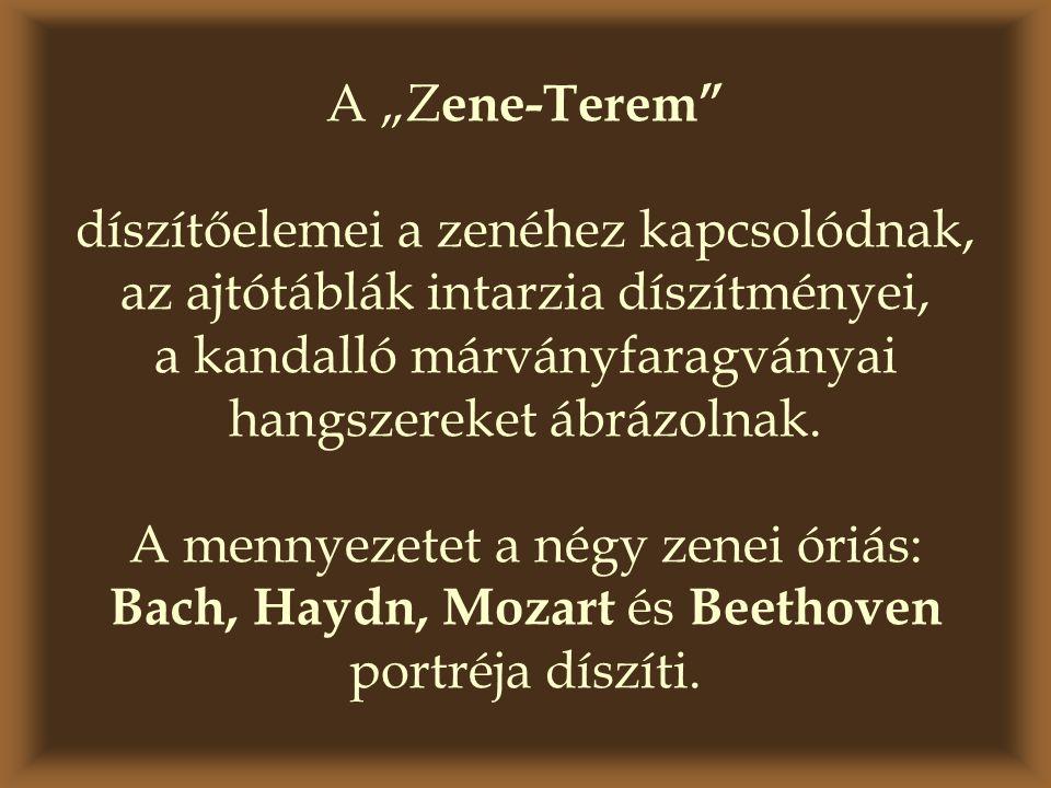 """A """"Z ene-Terem"""" díszítőelemei a zenéhez kapcsolódnak, az ajtótáblák intarzia díszítményei, a kandalló márványfaragványai hangszereket ábrázolnak. A me"""