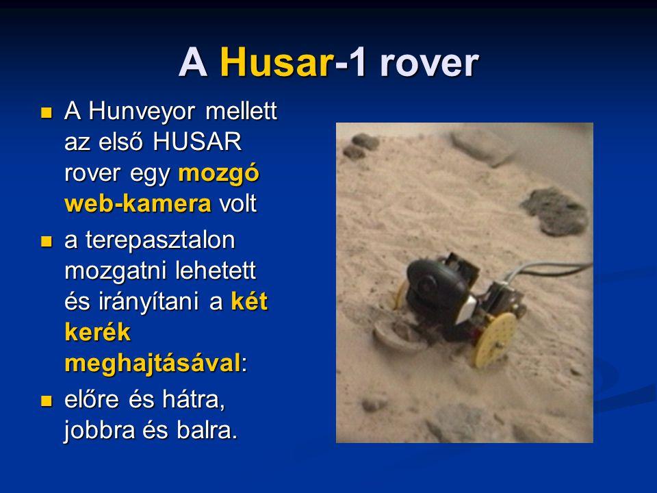A Husar-1 rover A Hunveyor mellett az első HUSAR rover egy mozgó web-kamera volt A Hunveyor mellett az első HUSAR rover egy mozgó web-kamera volt a terepasztalon mozgatni lehetett és irányítani a két kerék meghajtásával: a terepasztalon mozgatni lehetett és irányítani a két kerék meghajtásával: előre és hátra, jobbra és balra.